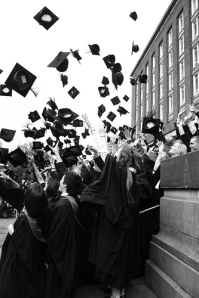 Graduate Can't Stop Throwing Hats in the Air - Byron City News Digest Graduation Edition