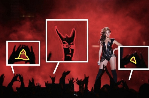 ... illuminati triangle symbols with hands as they worship her during the